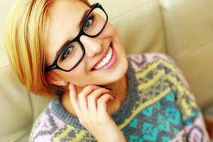cheerful woman in glasses -Rochester Eye & Laser Center