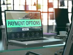 Modern Workplace with Laptop showing Landing Page with Payment Options Concept. Toned Image with Selective Focus. 3D Render..jpeg