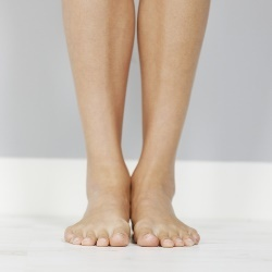 Young woman's legs on wooden floor sq.jpeg